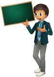 Boy holding sign Royalty Free Stock Image