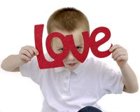 Boy Holding a sign love Royalty Free Stock Photos