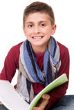 Boy holding a sketchbook Stock Photo