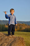 Boy holding small plane model Royalty Free Stock Image