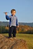 Boy holding small plane model Royalty Free Stock Image