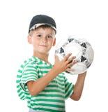 Boy holding soccer ball Stock Photos