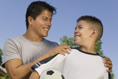 Boy holding soccer ball Royalty Free Stock Photography