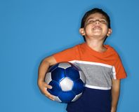 Boy holding soccer ball. Stock Photos