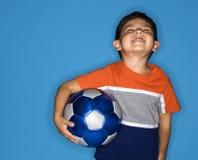Boy holding soccer ball.