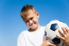 Boy holding a soccer ball Royalty Free Stock Images