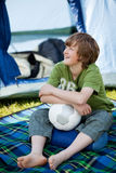 Boy Holding Soccer Ball In Front Of Tent Stock Photos