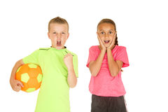Boy holding soccer ball girl with excited facial expression Royalty Free Stock Photos