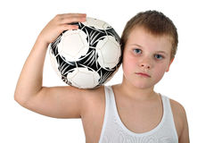 Boy holding soccer ball on his shoulder isolated Royalty Free Stock Image