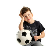 Boy holding soccer ball and recreation Royalty Free Stock Photography