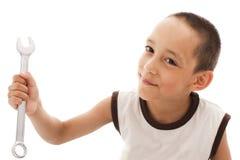 Boy holding spanner Royalty Free Stock Photos