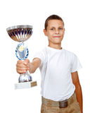 Boy holding sport trophy. With smile isolated over white background stock photography