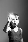 Boy holding a star in the hand Stock Images