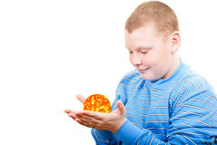 Boy holding a sun in the form of a star. On a white background Stock Image