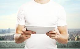 Boy holding tablet Stock Photos