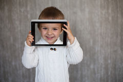 Boy, holding a tablet Stock Photography