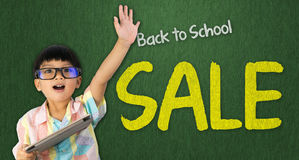 Boy holding tablet raise his hand for Back to School sale Stock Photo