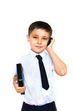 Boy holding talking on the phone Royalty Free Stock Photos