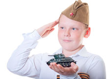 Boy holding tank. The boy is holding a plasticine model of the tank Royalty Free Stock Images