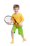Boy holding a tennis racket Stock Images