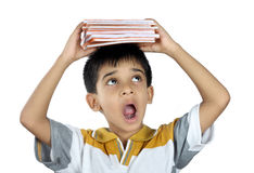 Boy Holding the Textbook with Expression Royalty Free Stock Images