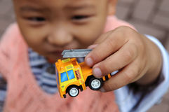 A boy holding a toy fire truck. Stock Photography