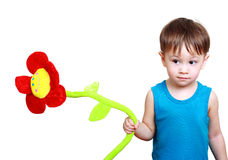 Boy holding toy flower Royalty Free Stock Photos