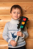 Boy is staying with traffic light Stock Photo