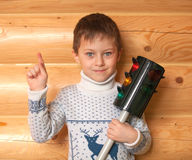 Little boy is holding traffic light Royalty Free Stock Image