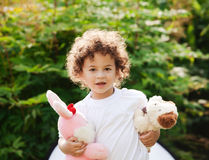 Boy is holding toys Stock Photography