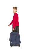 Boy holding travel bag walking away on white Stock Photos
