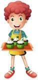 A boy holding a tray of cupcakes Stock Photos