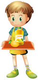 A boy holding a tray with mango juice Royalty Free Stock Images
