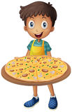 Boy holding tray of pizza Stock Photography