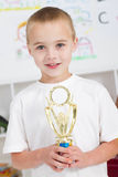 Boy holding trophy Stock Images