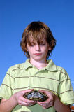Boy holding turtle Stock Image