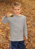 Boy holding turtle shell Royalty Free Stock Photo