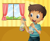 A boy holding two packs of bean candies Royalty Free Stock Photo