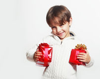 Boy holding two presents Stock Photo