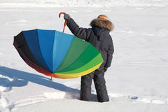 Boy holding umbrella at outside in winter Royalty Free Stock Images