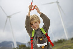 Boy Holding Umbrella At Wind Farm Stock Images