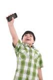 Boy holding up cellular phone Royalty Free Stock Image