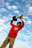 Boy holding up trophy Royalty Free Stock Photography