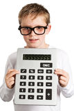 Boy holding very big calculator. Shoot in the studio against a white background Royalty Free Stock Photography