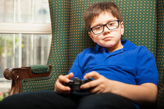 Boy holding a video game controller Stock Image