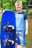 Boy Holding Wakeboard royalty free stock image