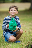 Boy holding a watering can Royalty Free Stock Photos