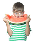 Boy holding a watermelon Royalty Free Stock Image