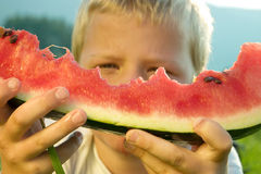 Boy holding watermelon Royalty Free Stock Images