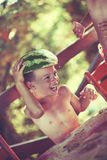 Boy holding watermelon as hat Stock Photos